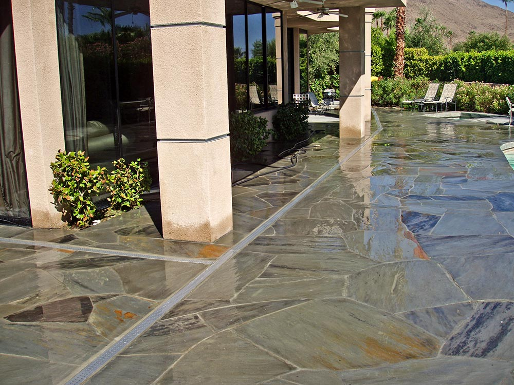 how to clear a pool deck drain